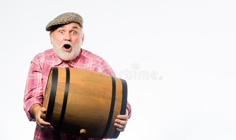 Winery concept. Homemade wine. Man bearded senior carry wooden barrel for wine white background. Producing wine family. Tradition. Fermentation product. Natural royalty free stock image