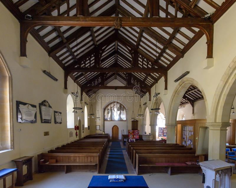 St Christopher`s Church - Nave view from Altar. Winfrith Newburgh, England - July 23, 2018: St Christopher`s Church - Nave view from Altar stock photography