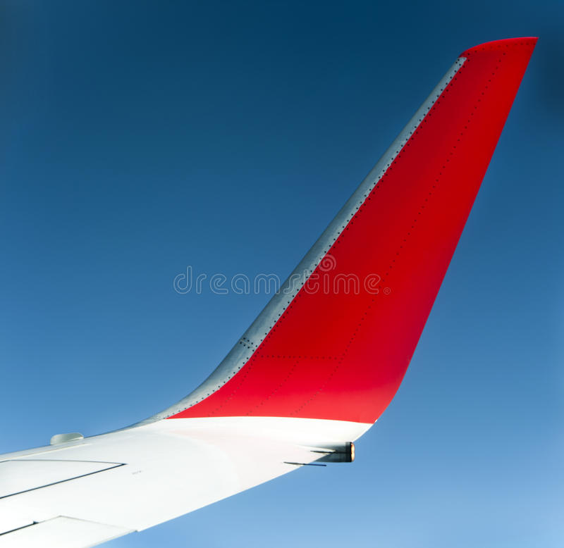 Wing aircraft. Wing of aircraft against clear blue sky stock image