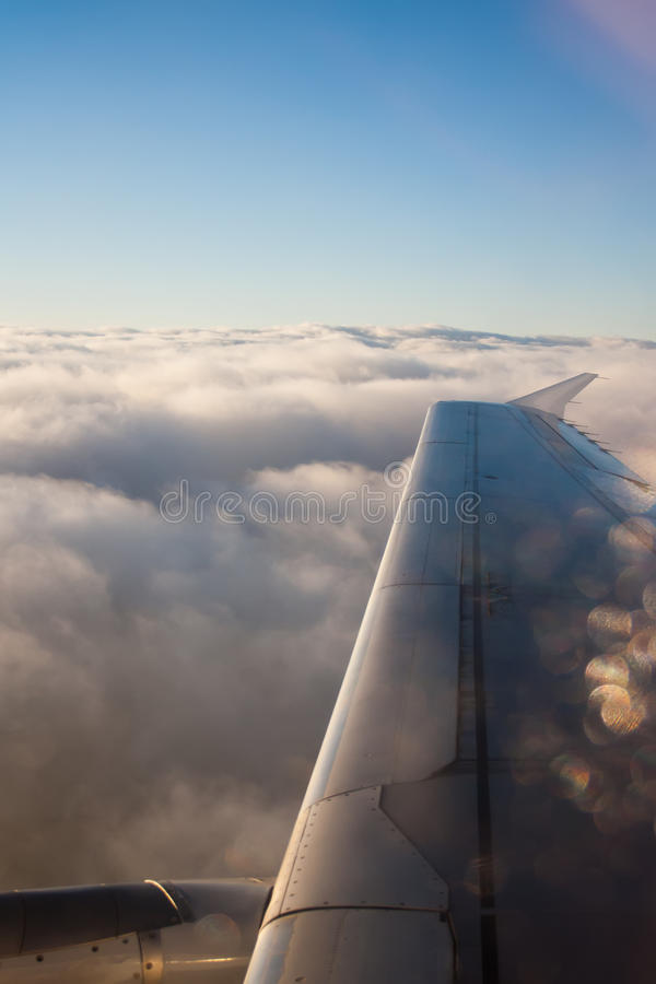 Wing aircraft. With clouds and blue sky stock image