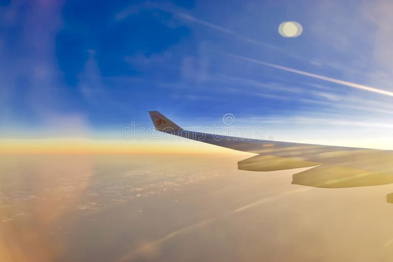 Wing of an airplane with beautiful view stock photography