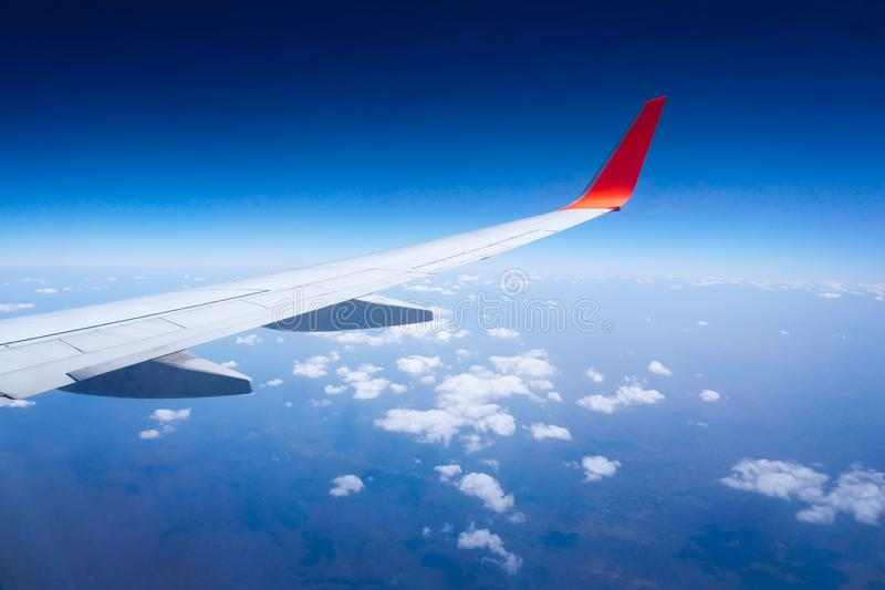 Wing airplane with blue sky from window,Beautiful view from commercial airplane window. Wing airplane with blue sky and clouds from window,Beautiful view from stock photography