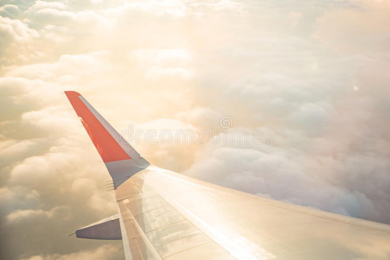 Wing of airplane on cloud sky from window in morning. Wing of airplane on cloud sky from window stock photos