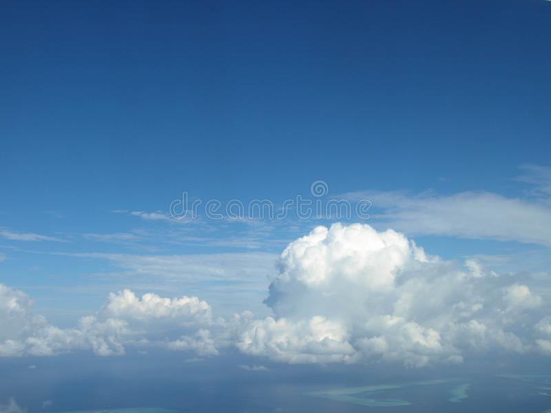 Wing of an airplane with clouds. And blue sky stock images