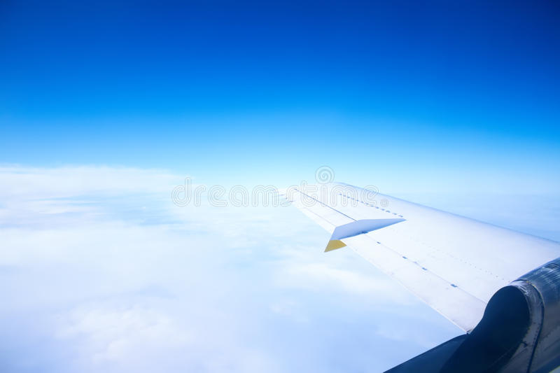 Wing in the blue sky with white clouds stock images