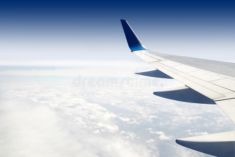 The wing of a jet passenger airliner. The wing of a jet passenger airliner on the background of a beautiful blue sky over the sea. Beautiful view took from the royalty free stock photography