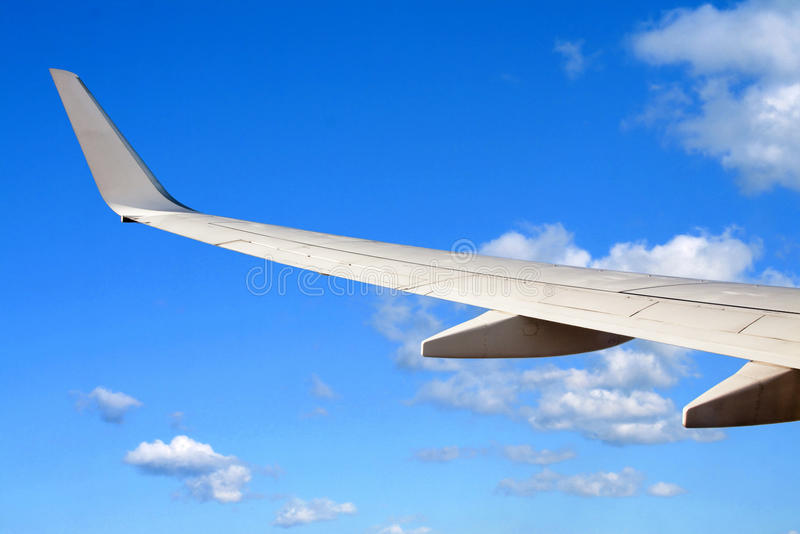 Download Wing of a plane stock image. Image of cloudy, cruise - 11285355