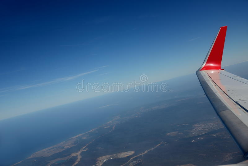 Download Wing Of Plane Above Earth. Blue Sky. Stock Image - Image: 38851645