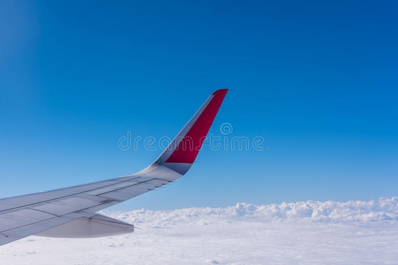 Wing of plane with blue sky and cloud royalty free stock photos