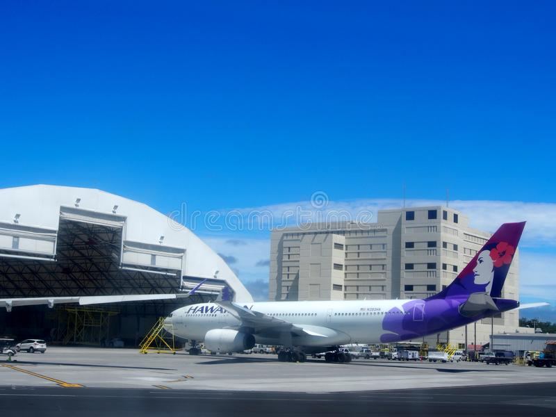 Wing of plane and Hawaiian Airlines airplanes as they sit at hanger as they undergo repairs royalty free stock photography