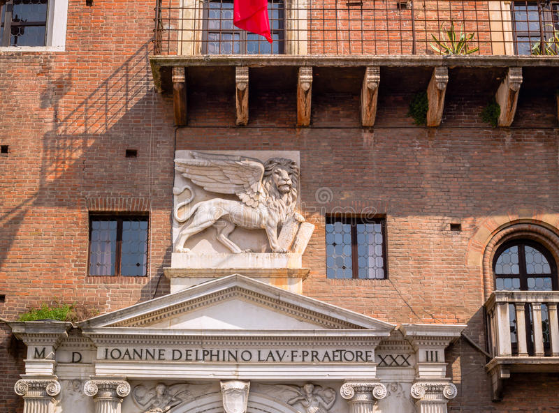 Winged lion bas. Winged lion under door of old church in verona italy royalty free stock photography