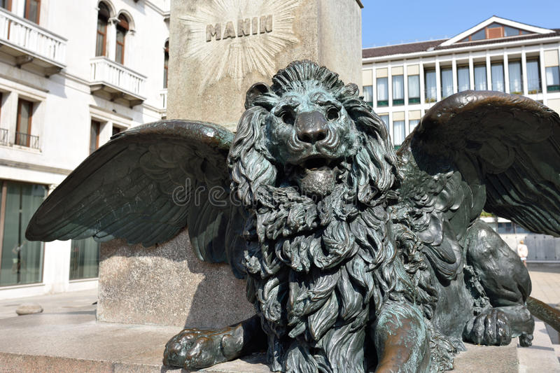 Winged Lion sculpture. Winged Lion at Campo Manin. Detail from the 1875 monument of Manin by Luigi Borro in Venice, Italy royalty free stock image