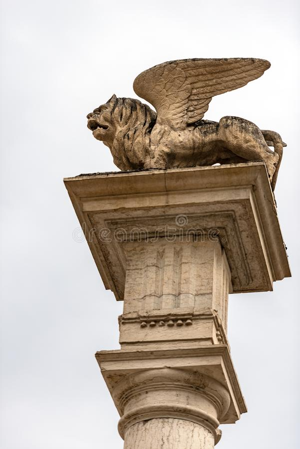 Winged lion of St Mark symbol of Venice - Feltre Veneto Italy. Winged lion of St Mark Leone di San Marco on the top of a column, symbol of the Venetian Republic royalty free stock images