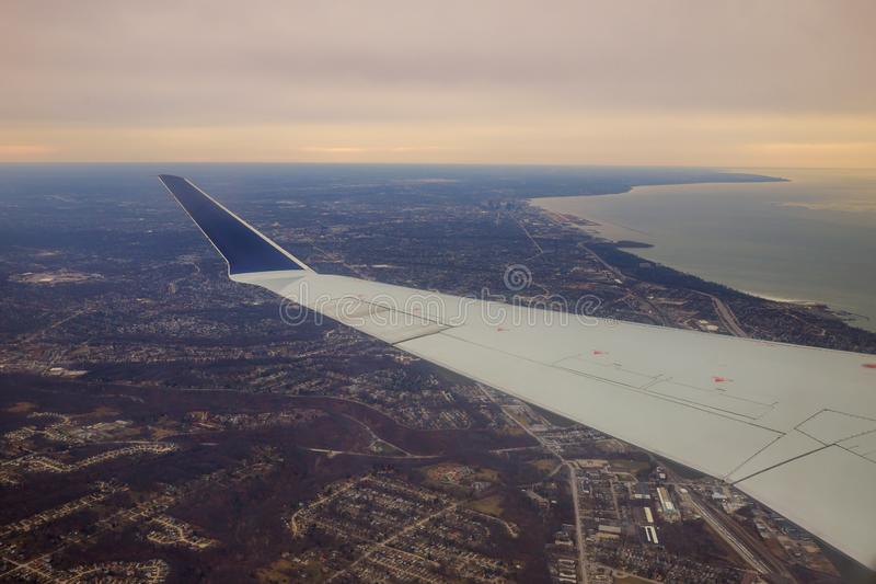 Winglet in graduated dark blue sky with a view of big city below in Cleveland Ohio stock photography