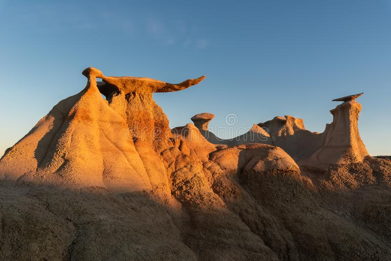 The Wings rock formation, Bisti/De-Na-Zin Wilderness Area, New Mexico, USA. The Wings rock formation at sunrise, Bisti/De-Na-Zin Wilderness Area, New Mexico, USA royalty free stock photos