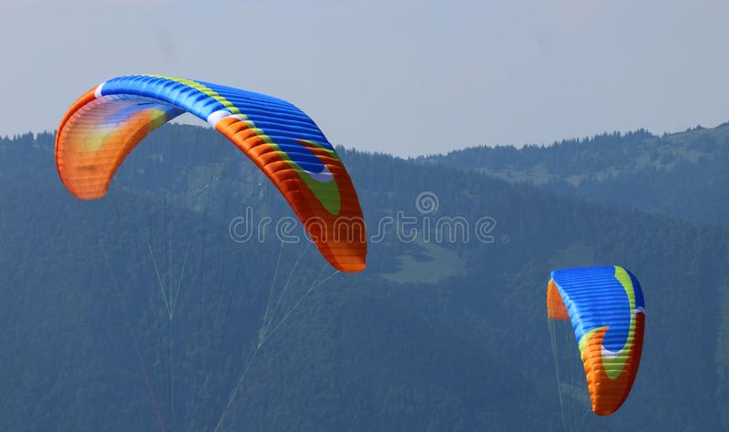The wings of two paragliders. royalty free stock photo