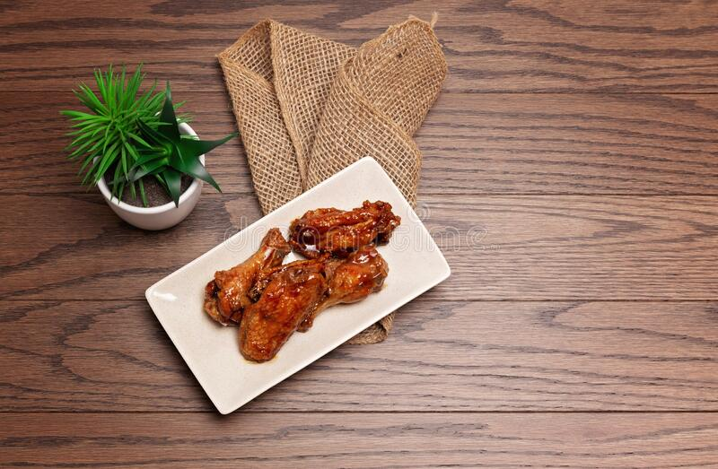 Wings on a wooden background royalty free stock images