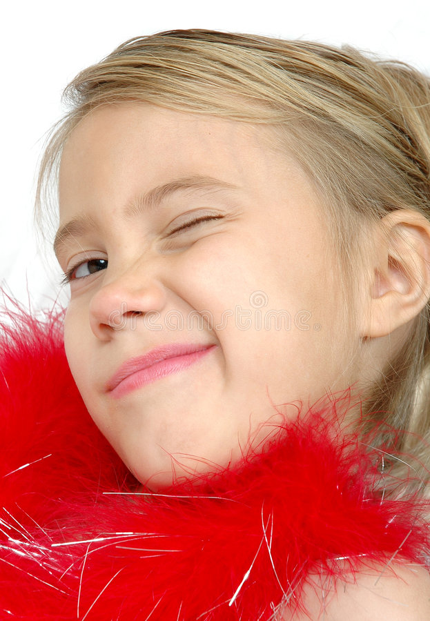 Wink Wink. Little girl winks at the camera stock photos