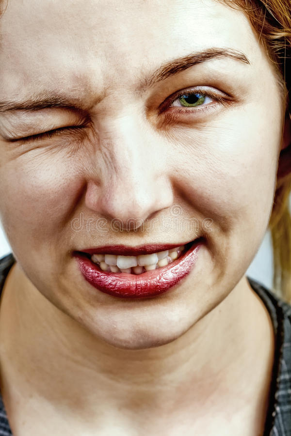 Wink - Woman Making A Funny Face Royalty Free Stock Photo