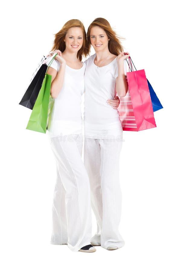 Winkelende meisjes stock foto's
