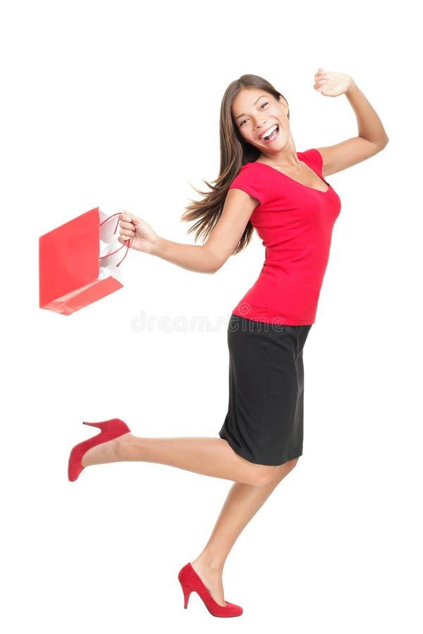Winkelende vrouw in zak van de vreugde de lopende holding royalty-vrije stock afbeelding
