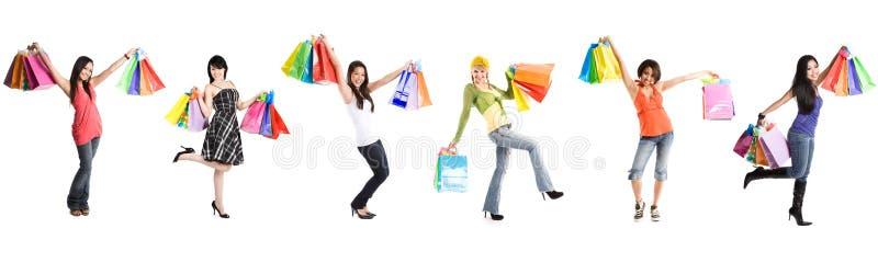 Winkelende vrouwen stock foto's