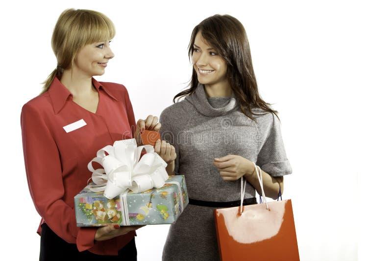 Winkelmanager en klant stock fotografie