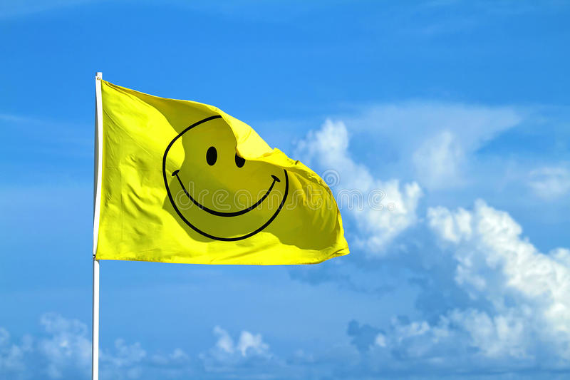 Winking happy smiley face flag royalty free stock photography