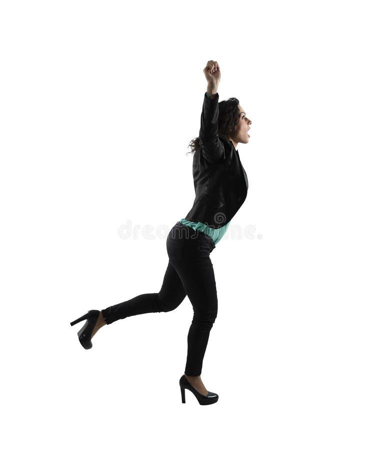 Winnende onderneemster die loopt Geïsoleerdj op witte achtergrond stock foto's