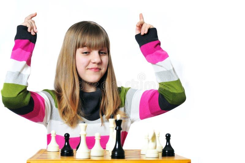 Winner. Teen girl win chess, she madecheckmate stock photo