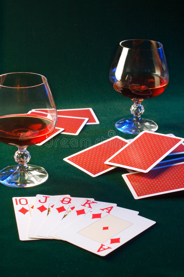 Winner. Playing cards and glasses of brandy on a playing table stock photo