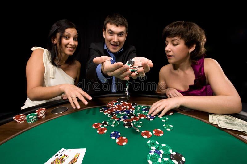 Winner. Stylish man wins in the casino over black stock photos