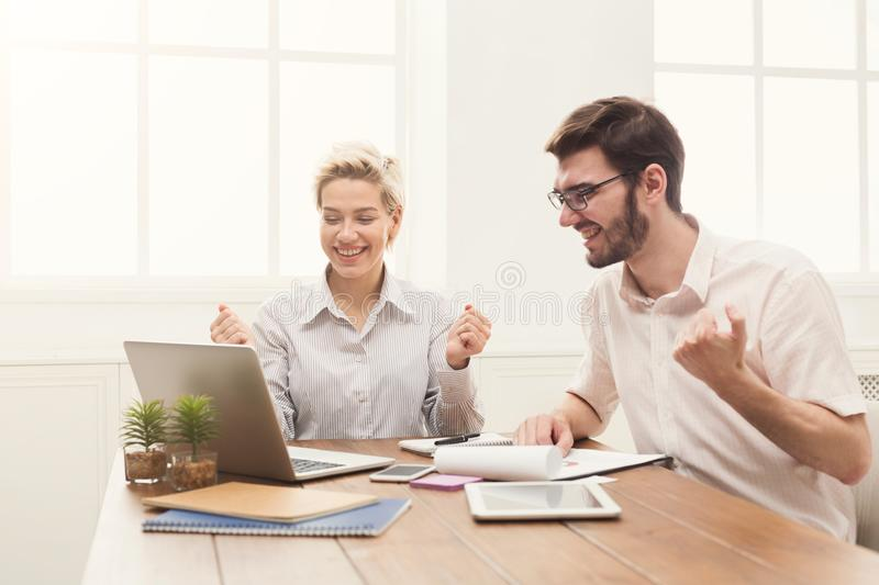 Young happy business partners in office stock photo