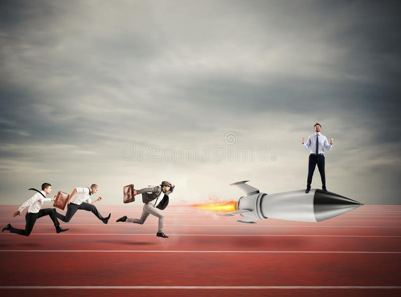 Winner businessman over a fast rocket. Concept of business competition stock photography