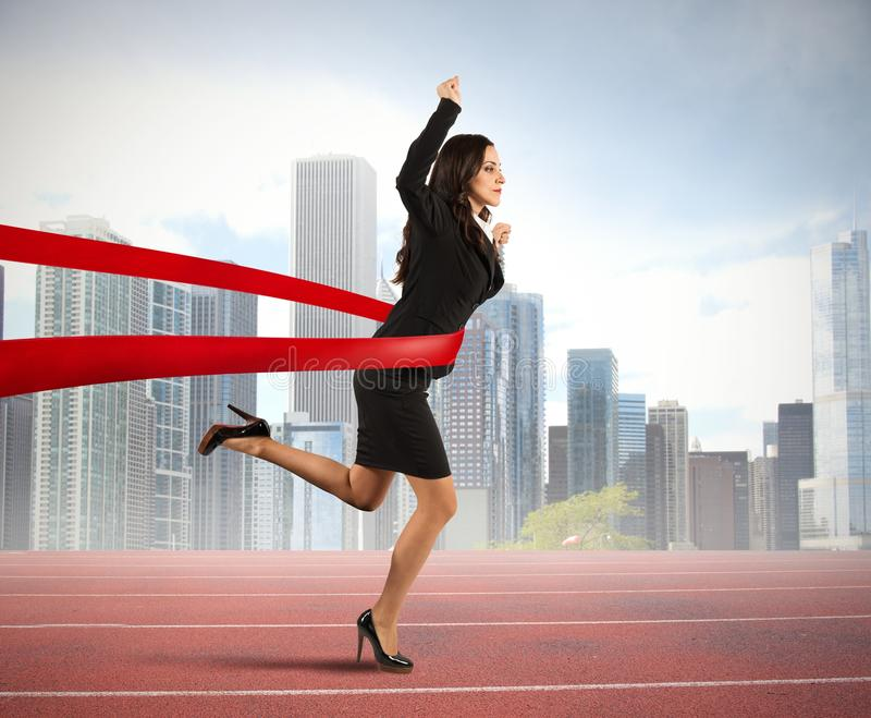 Winner businesswoman. Concept of winner businesswoman in a finish line royalty free stock image