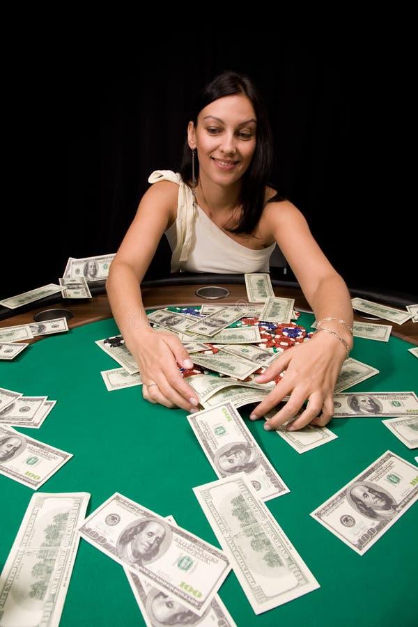 Winner in casino. Pretty caucasian girl wins cash in Vegas casino stock images