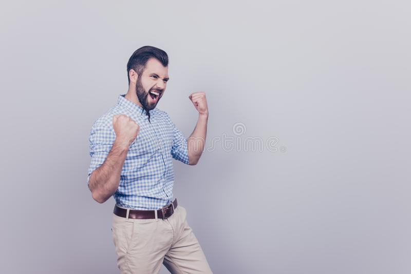 Winner! A dream of the young bearded brunet entrepreneur came tr royalty free stock photography