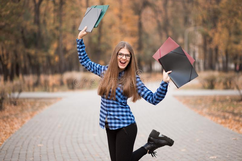 Winner girl euphoric wearing in blue shirt, feeling great things on career way, working toward success and reached it stock images