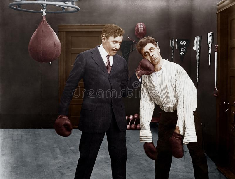 Winner and loser in boxing match stock image