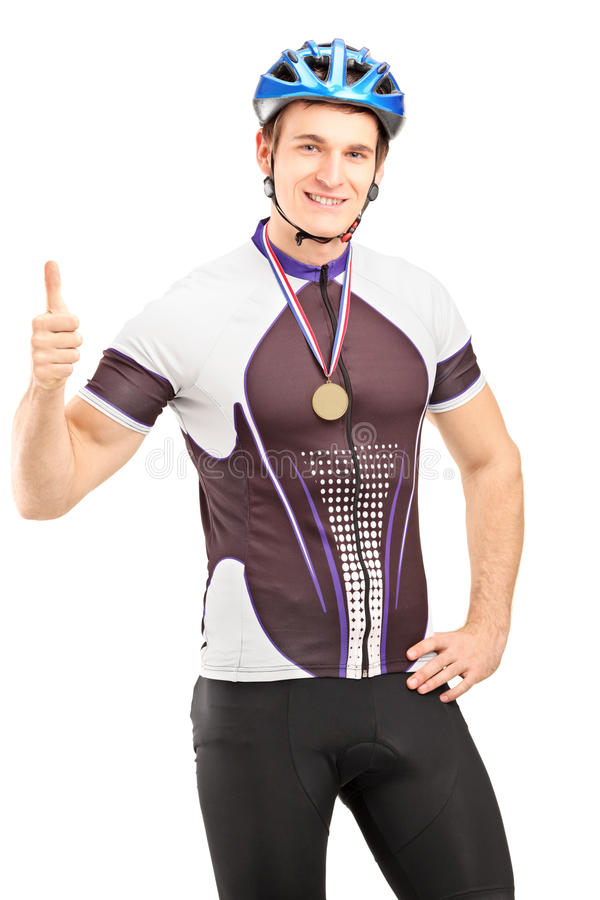 Download Winner Male Cyclist With A Golden Medal Giving A Thumb Up Stock Photo - Image: 28994618