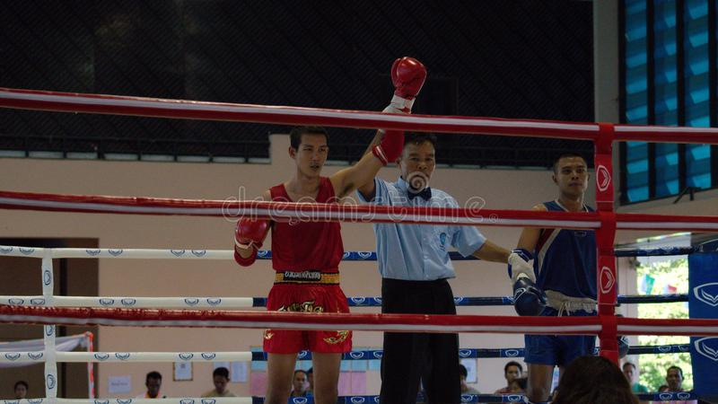 The winner. Muay thai boxing. The boxers fighting on sport boxing ring. royalty free stock photo