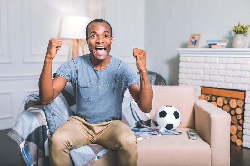 Overwhelmed man celebrating the victory royalty free stock image