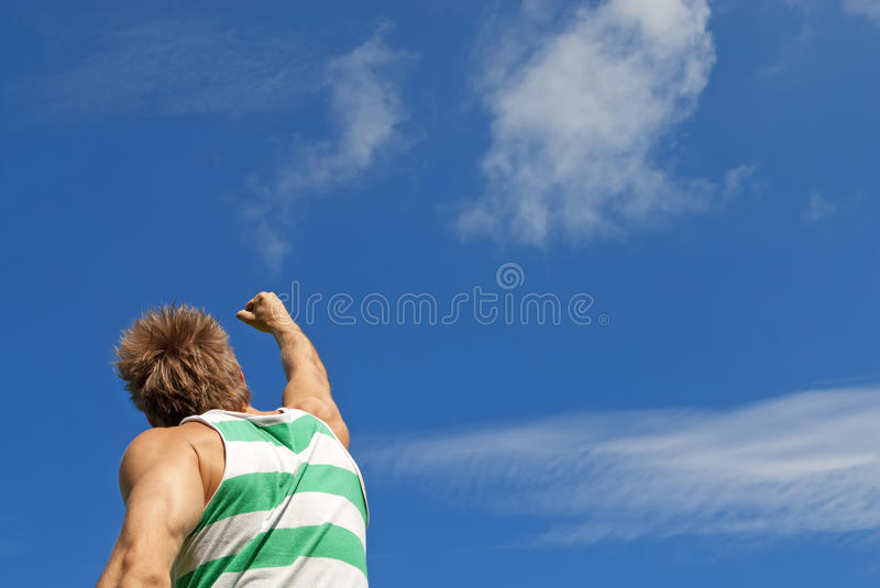 Download The Winner. Sporty Guy With His Arm Raised In Joy. Stock Image - Image: 26503487