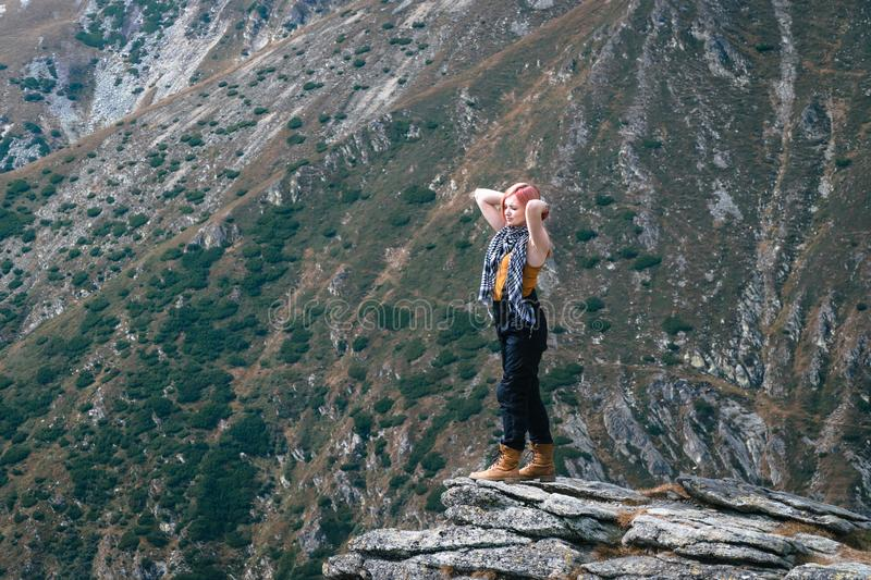 Winner. Success concept. Hiker girl after hiking to mountain top. copy space. adventure Romania stock photo