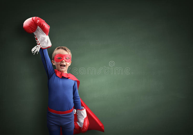 The Winner. Superhero child winner with boxing gloves concept for winning, childhood, imagination, aspirations and strength