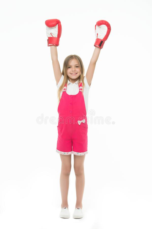 Winner takes it all. Girl on smiling face posing with boxing gloves as winner, isolated white background. Kid long hair stock photography