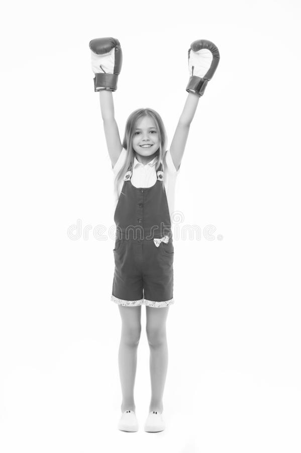Winner takes it all. Girl on smiling face posing with boxing gloves as winner, isolated white background. Kid long hair. Celebrates victory. Girls power concept royalty free stock image