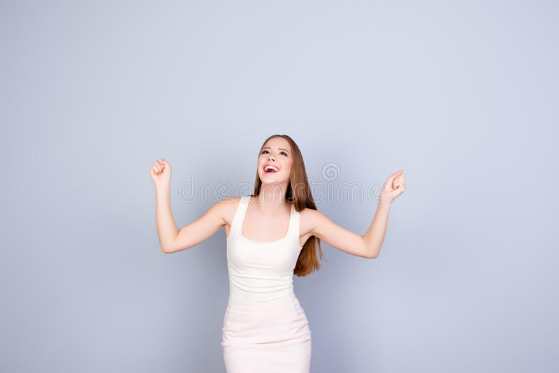 Winner! Yes! Young carefree dreamy cute girl in white dress on p royalty free stock photo