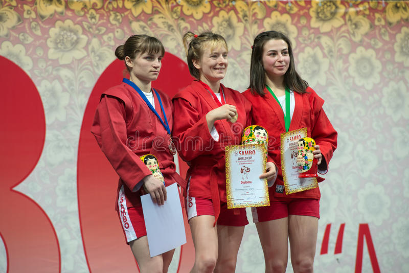 Winners category of women 48 kg. RUSSIA, MOSCOW - MARCH 27: Winners in the weight category of women 48 kg of the World Cup Memorial A. Kharlampiev in Stadium royalty free stock image