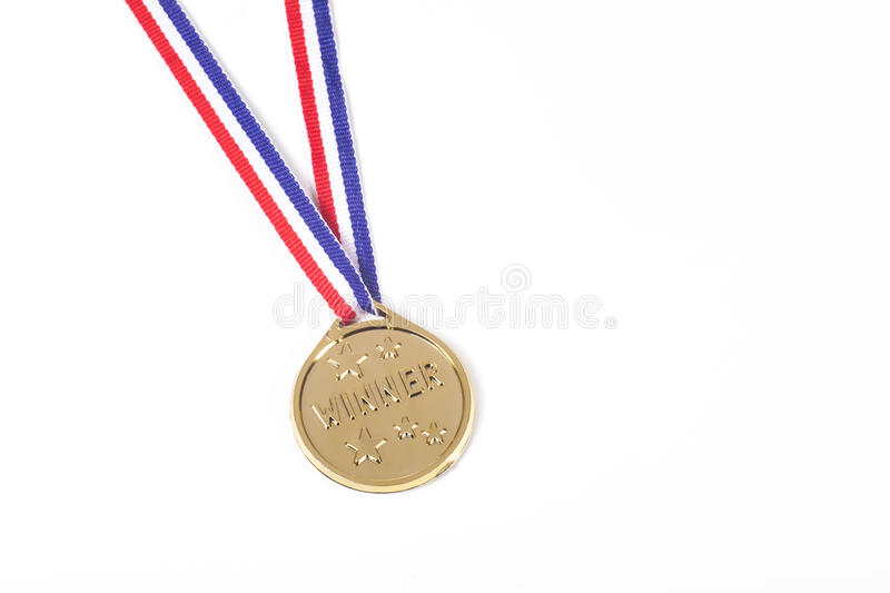 Winners gold medal on a ribbon isolated on white stock photography